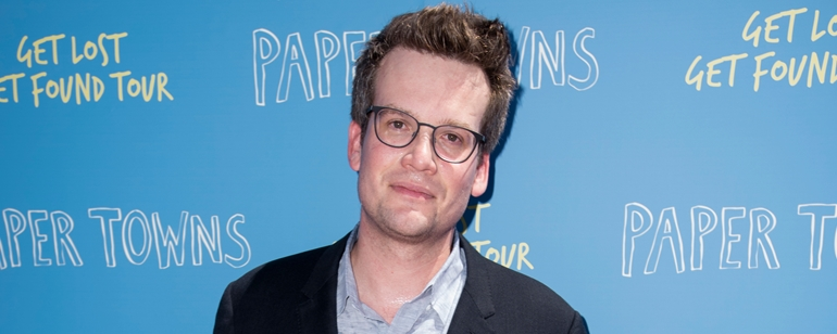 "DALLAS, TX - JULY 16:  John Green poses for a photo on the ""Paper Towns"" Get Lost Get Found tour at The Bomb Factory on July 16, 2015 in Dallas, Texas.  (Photo by Cooper Neill/Getty Images for Allied-THA)"